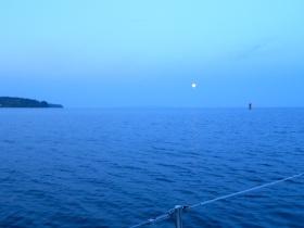 Full moon going down