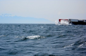 A passing barge heading into the waves