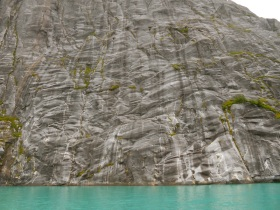 Glacier polished cliffs and milky blue water