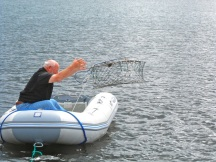 Tossing the crab trap...
