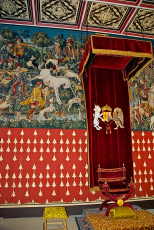 The King's chair beneath the recreated tapestries.