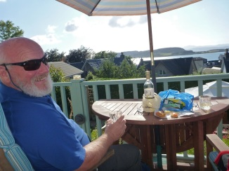 Enjoying a nosh on our deck looking out over Oban harbor..lovely