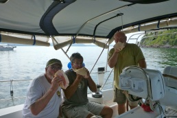 Marty giving conch blowing lessons