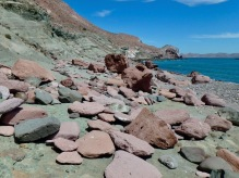 The red and green rocks on the north beach Isla San Francisco