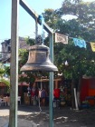 For some reason the church bell is in front of the church!