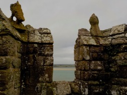 Isle of Anglesey from the ramparts..notice the eroded gargoyles