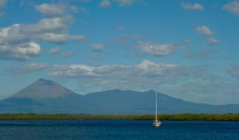 Happy Dance at anchor under one of many active volcanoes