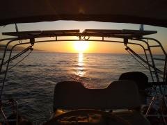 Sunrise directly astern...we're finally heading west!